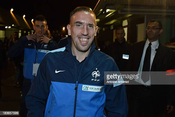 French national football team forward Franck Ribery arrives at a harnessed trot race on October 8 2013 in Paris France