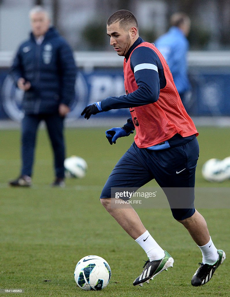 French national football team forward Karim Benzema runs with a ball during a training session in Clairefontaine-en-Yvelines, near Paris, on March 20, 2013, two days ahead of a World Cup 2014 qualifying football match against Georgia to be held at the stade de France in Saint-Denis, north of Paris.