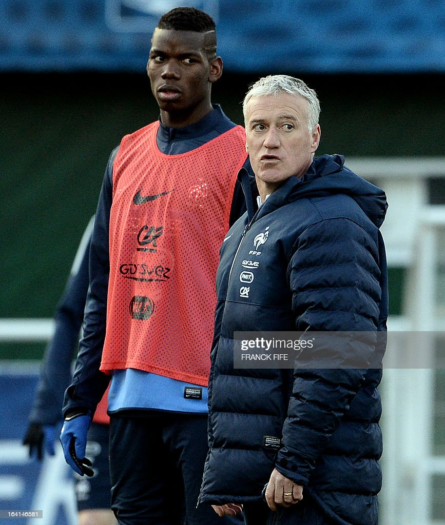 French national football team head coach Didier Deschamps (R) speaks with midfielder Paul Pogba during a training session in Clairefontaine-en-Yvelines, near Paris, on March 20, 2013, two days ahead of a World Cup 2014 qualifying football match against Georgia to be held at the stade de France in Saint-Denis, north of Paris.