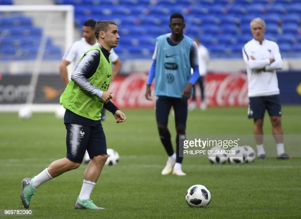 French national football team player Antoine Griezmann attends a training session, on June 8 at the Groupama Stadium in Decines-Charpieu near Lyon,...