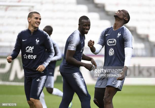 French national football team players Antoine Griezmann Benjamin Mendy and Paul Pogba run during a training session on June 8 at the Groupama Stadium...
