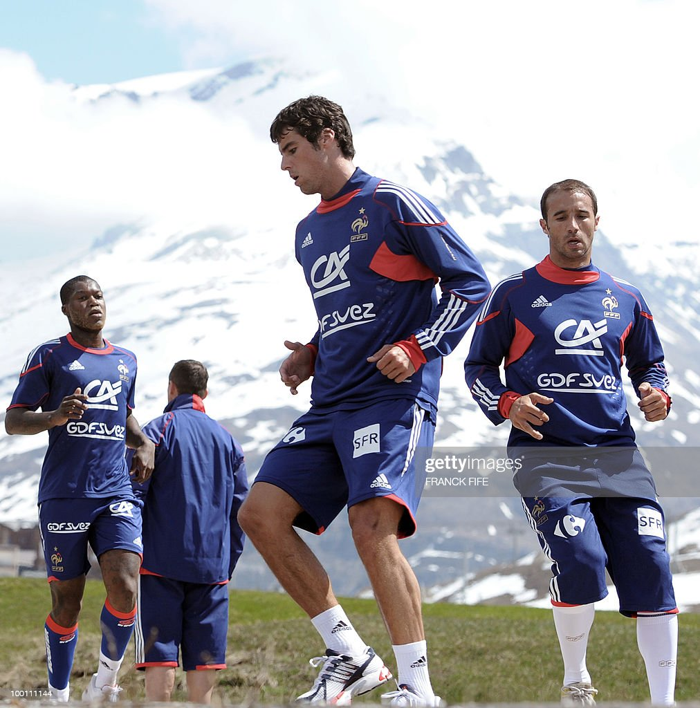 French national football team players (From L) Djibrill Cisse, Yoann Gourcuff and Marc Planus jog during a training session on May 21, 2010 around Tignes' lake, in the French Alps, as part of their preparation for the upcoming World Cup 2010 in South Africa. France will play Uruguay in Capetown in its group A opener match next June 11.