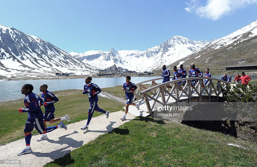 French national football team players (From L) Florent Malouda, Gael Clichy, Thierry Henry, Yoann Gourcuff and teammates jog during a training session on May 21, 2010 around Tignes' lake, in the French Alps, as part of their preparation for the upcoming World Cup 2010 in South Africa. France will play Uruguay in Capetown in its group A opener match next June 11.
