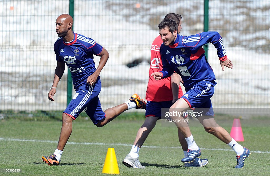 French national football team players Nicolas Anelka(L) and Andre-Pierre Gignac run during a training session, on May 24, 2010, near Tignes in the French Alps, as part of the preparation for the upcoming World Cup 2010. France will play against Uruguay in Capetown in its group A opener match on June 11.