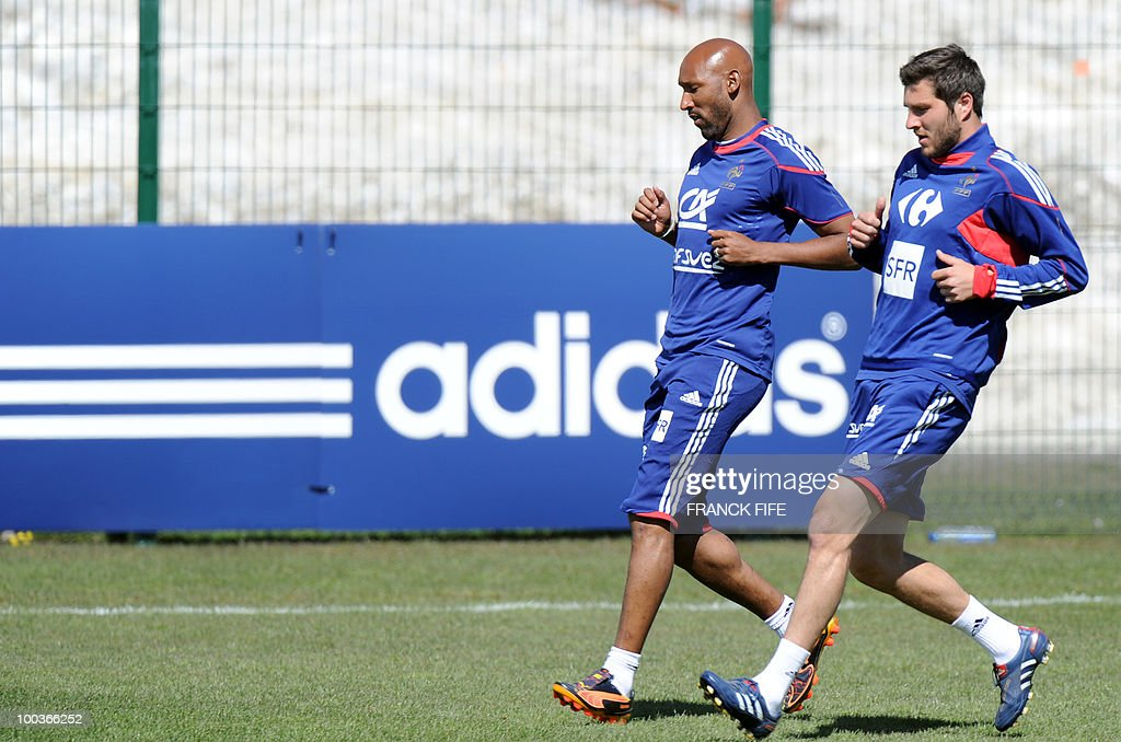 French national football team players Nicolas Anelka (L) and Andre-Pierre Gignac run during a training session, on May 24, 2010, near Tignes in the French Alps, as part of the preparation for the upcoming World Cup 2010. France will play against Uruguay in Capetown in its group A opener match on June 11.