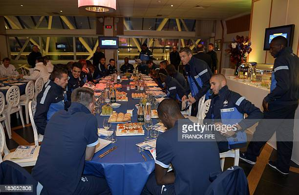 French national football team players wait for their dinner at Vincennes racetrack where some of the French players are to take part in a harnessed...