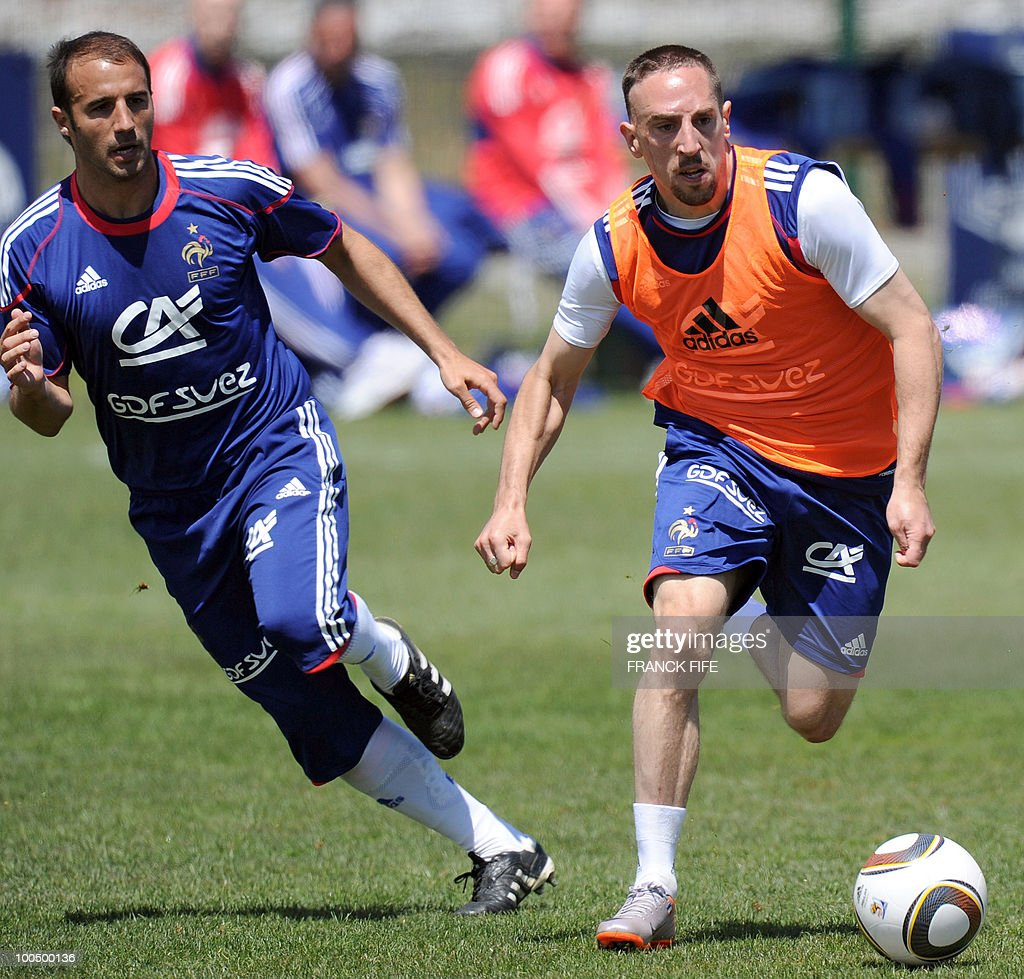 French national football team's captain Franck Ribery (R) runs next to his teammate, defender Marc Planus during a training session, on May 25, 2010, near Tignes in the French Alps, as part of the preparation for the upcoming World Cup 2010. France will play against Uruguay in Capetown in its group A opener match on June 11.