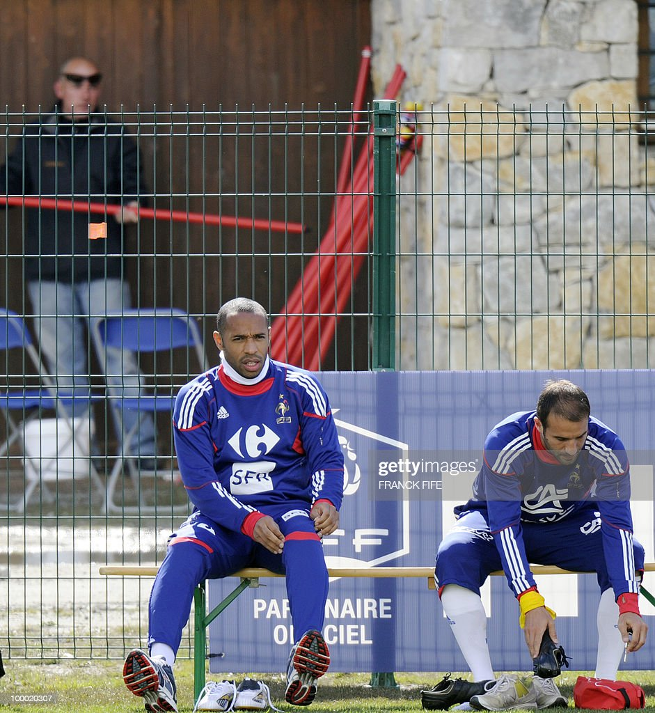 French national football team's captain Thierry Henry (L) and defenderMarc Planus attend a training session, on May 20 , 2010 in Tignes, French Alps, as part of their altitude training in preparation for the 2010 World cup in South Africa. France will play Uruguay in Capetown in its group A opener match on June 11.