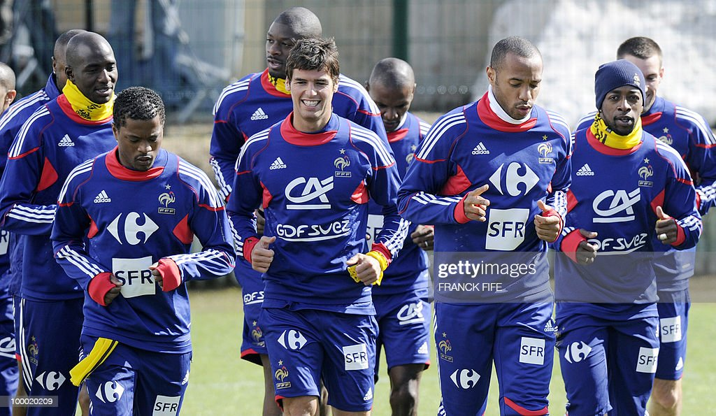 French national football team's captain Thierry Henry (1st row, 2ndR) and midfielder Yoann Gourcuff (1st row,2ndL), flanked by teammates, run during a training session, on May 20 , 2010 in Tignes, French Alps, as part of their altitude training in preparation for the 2010 World cup in South Africa. France will play Uruguay in Capetown in its group A opener match on June 11.
