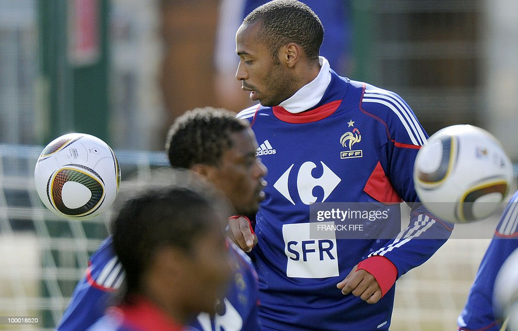 French national football team's captain Thierry Henry (C) controls the ball during a training session, on May 20, 2010 in Tignes, French Alps, as part of their altitude training in preparation for the 2010 World cup in South Africa. France will play Uruguay in Capetown in its group A opener match on June 11.