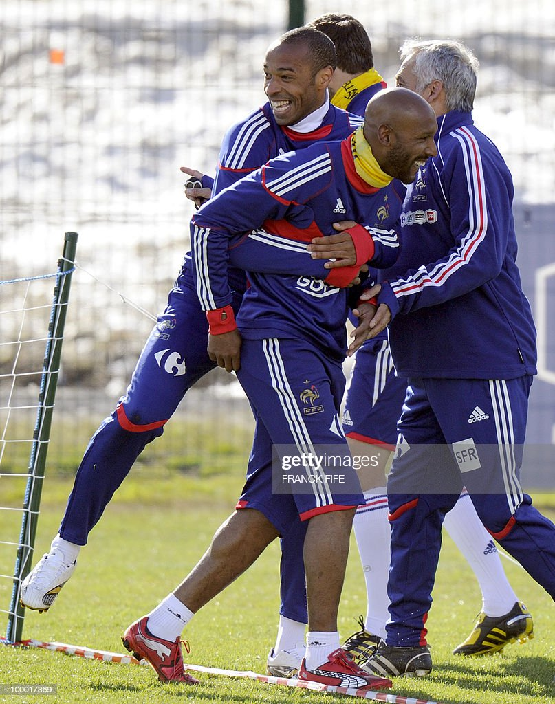French national football team's captain Thierry Henry (2nd ground) jokes with Nicolas Anelka (first ground) during a training session, on May 20 , 2010 in Tignes, French Alps, as part of their altitude training in preparation for the 2010 World cup in South Africa. France will play Uruguay in Capetown in its group A opener match on June 11.
