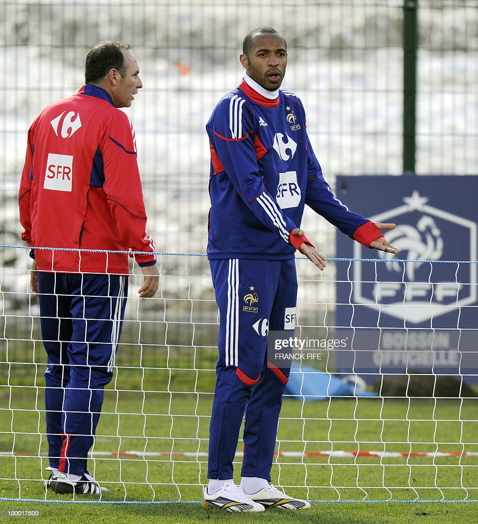 French national football team's captain Thierry Henry (R) reacts during a training session, on May 20, 2010 in Tignes, French Alps, as part of the preparation for the upcoming Wolrd Cup 2010. France will play Uruguay in Capetown in its group A opener match on June 11.