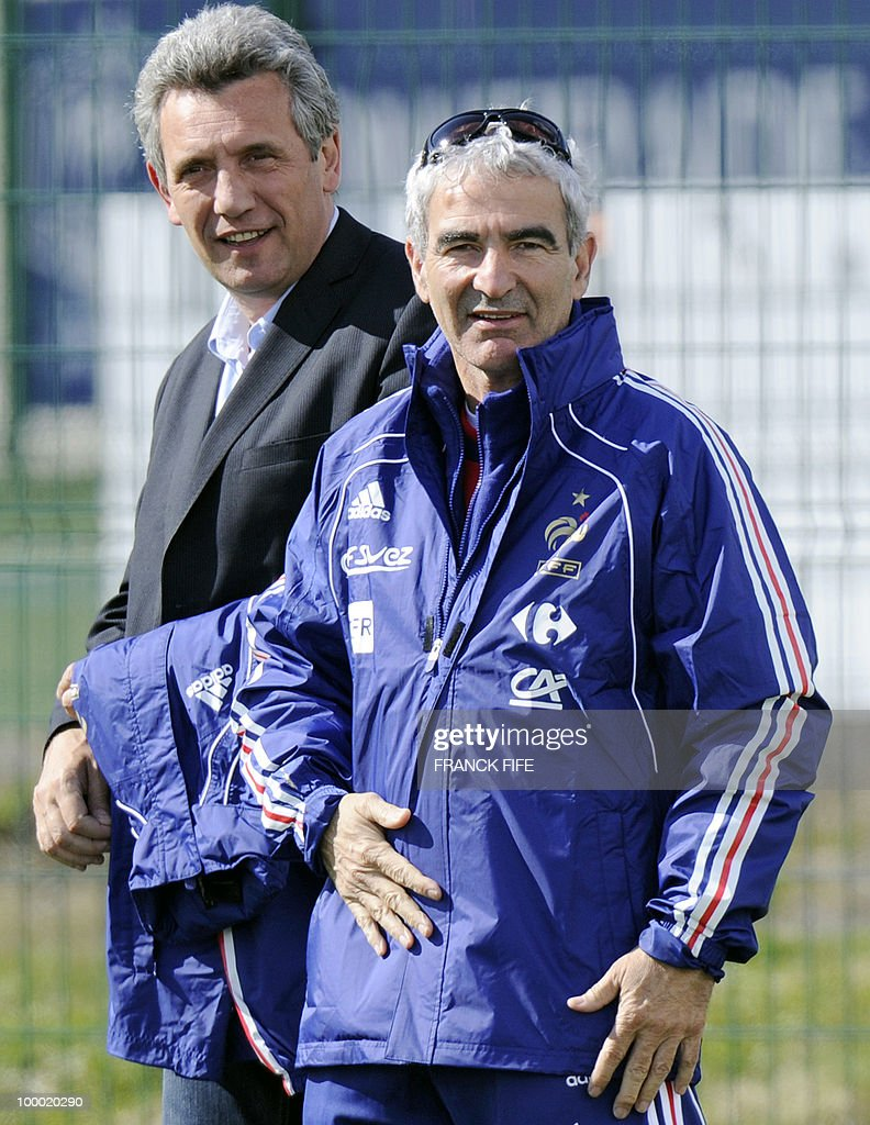 French national football team's coach Raymond Domenech (R) and French national handball team coach Claude Onesta arrive for a training session, on May 20 , 2010 in Tignes, French Alps, as part of their altitude training in preparation for the 2010 World cup in South Africa. France will play Uruguay in Capetown in its group A opener match on June 11.