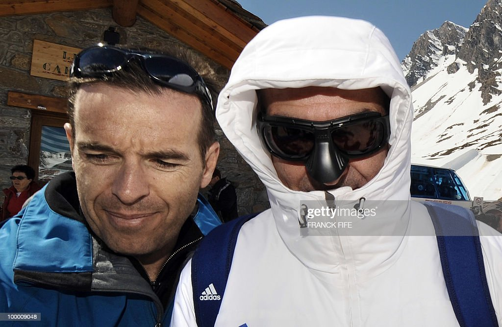 French national football team's coach Raymond Domenech (R) arrives in Tignes, French Alps, on May 20, 2010 after having spent the night with his team at the top of a glacier. The French national team slept in altitude last night, as part of their altitude training in preparation for the 2010 World cup in South Africa.