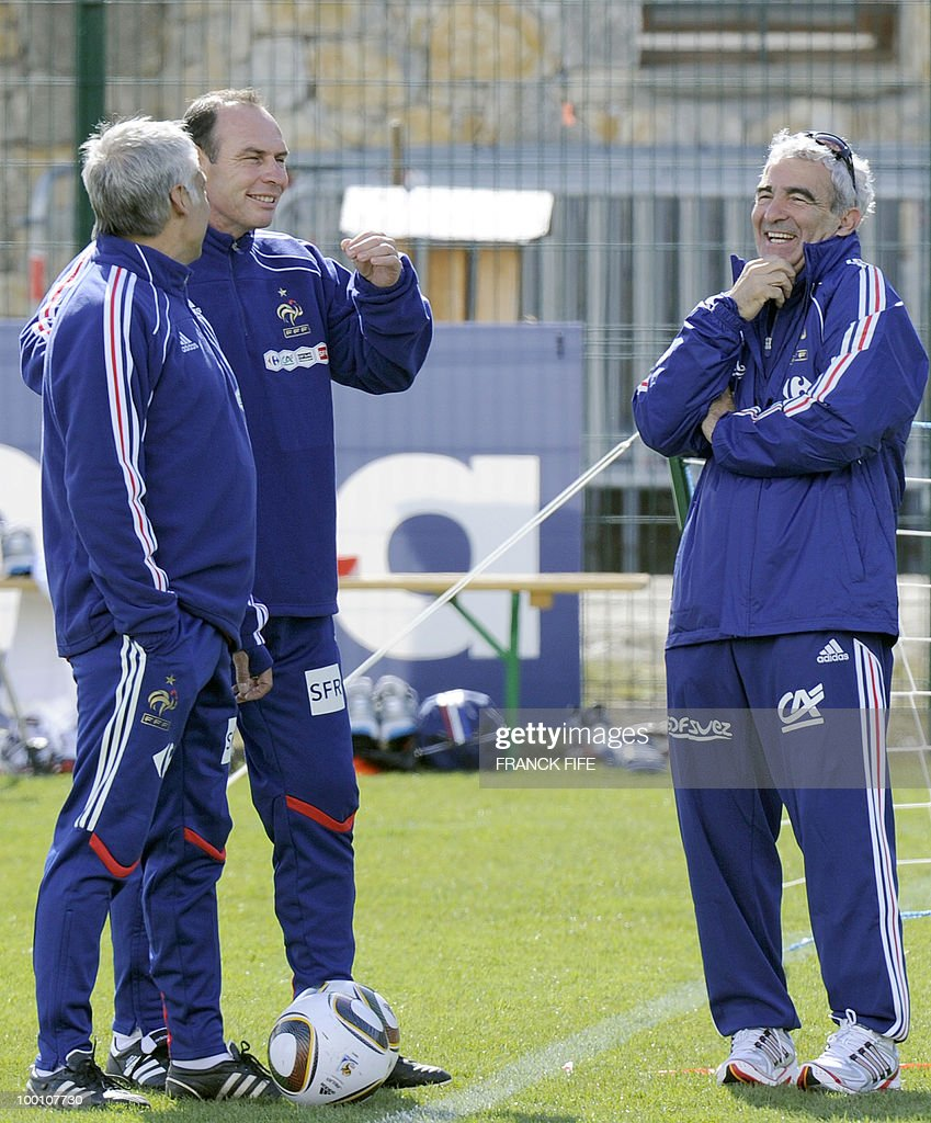 French national football team's coach Raymond Domenech (R) chats with his assistant Alain Boghossian (C) and Pierre Mankowski during a training session, on May 20, 2010 in Tignes, French Alps, as part of their altitude training in preparation for the 2010 World cup in South Africa. France will play Uruguay in Capetown in its group A opener match on June 11.