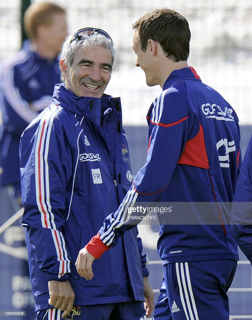 French national football team's coach Raymond Domenech (L) chats with defender Sebastien Squillaci during a training session, on May 20 , 2010 in Tignes, French Alps, as part of their altitude training in preparation for the 2010 World cup in South Africa. France will play Uruguay in Capetown in its Group A opener match on June 11.