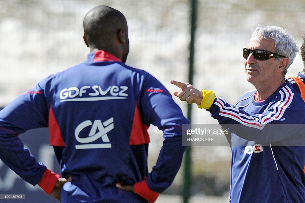 French national football team's coach Raymond Domenech (R) gives instructions to players during a training session, on May 24, 2010, near Tignes in the French Alps, as part of the preparation for the upcoming World Cup 2010. France will play against Uruguay in Capetown in its group A opener match on June 11.