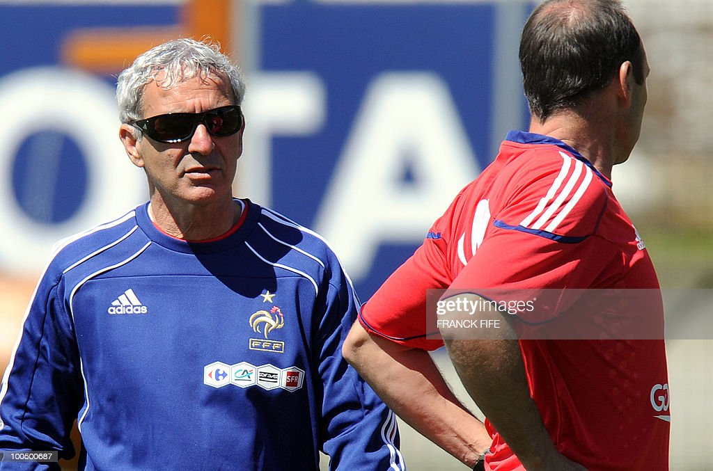 French national football team's coach Raymond Domenech (L) looks as his players during a training session, on May 25, 2010, near Tignes in the French Alps, as part of the preparation for the upcoming World Cup 2010. France will play against Uruguay in Capetown in its group A opener match on June 11.