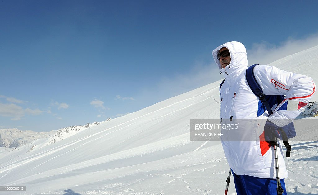 French national football team's coach Raymond Domenech looks at the view upon his arrival at the top of the Tignes glacier on May 19, 2010 in the French Alps. The French national team should sleep in altitude tonight and climb up the glacier on May 20, if weather permitting, as part of their altitude training in preparation for the 2010 World cup in South Africa.