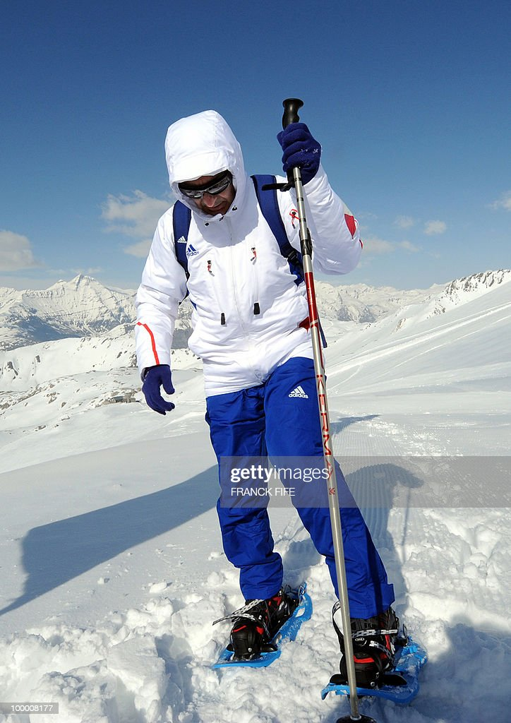 French national football team's coach Raymond Domenech puts snowshoes on upon his arrival at the top of the Tignes glacier on May 19, 2010 in the French Alps. The French national team should sleep in altitude tonight and climb up the glacier on May 20, if weather permitting, as part of their altitude training in preparation for the 2010 World cup in South Africa.