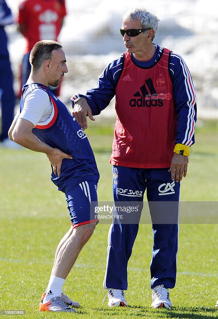 French national football team's coach Raymond Domenech (R) speaks to forward Franck Ribery during a training session on May 24, 2010, near Tignes in the French Alps, as part of the preparation for the upcoming World Cup 2010. France will play against Uruguay in Capetown in its group A opener match on June 11.