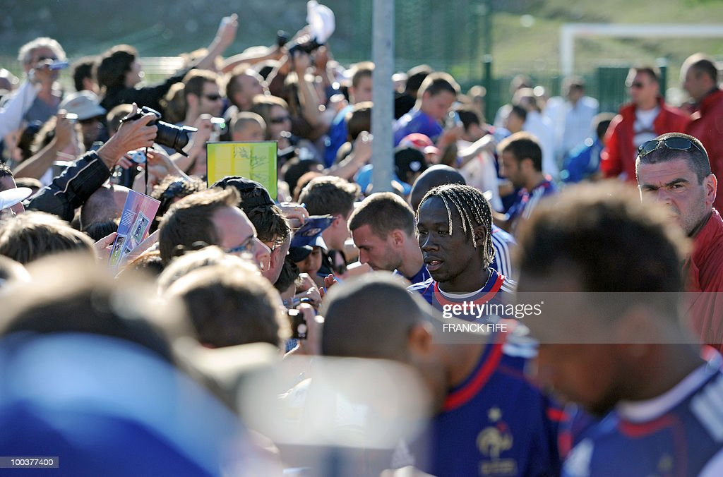 French national football team's defender Bakary Sagna (C) signs a autographs after a training session, on May 24, 2010, near Tignes in the French Alps, as part of the preparation for the upcoming World Cup 2010. France will play against Uruguay in Capetown in its group A opener match on June 11.
