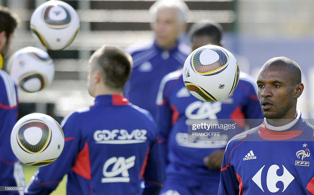 French national football team's defender Eric Abidal juggles with a ball during a training session, on May 20 , 2010 in Tignes, French Alps, as part of the altitude training in preparation for the 2010 World cup in South Africa. France will play Uruguay in Capetown in its group A opener match on June 11.