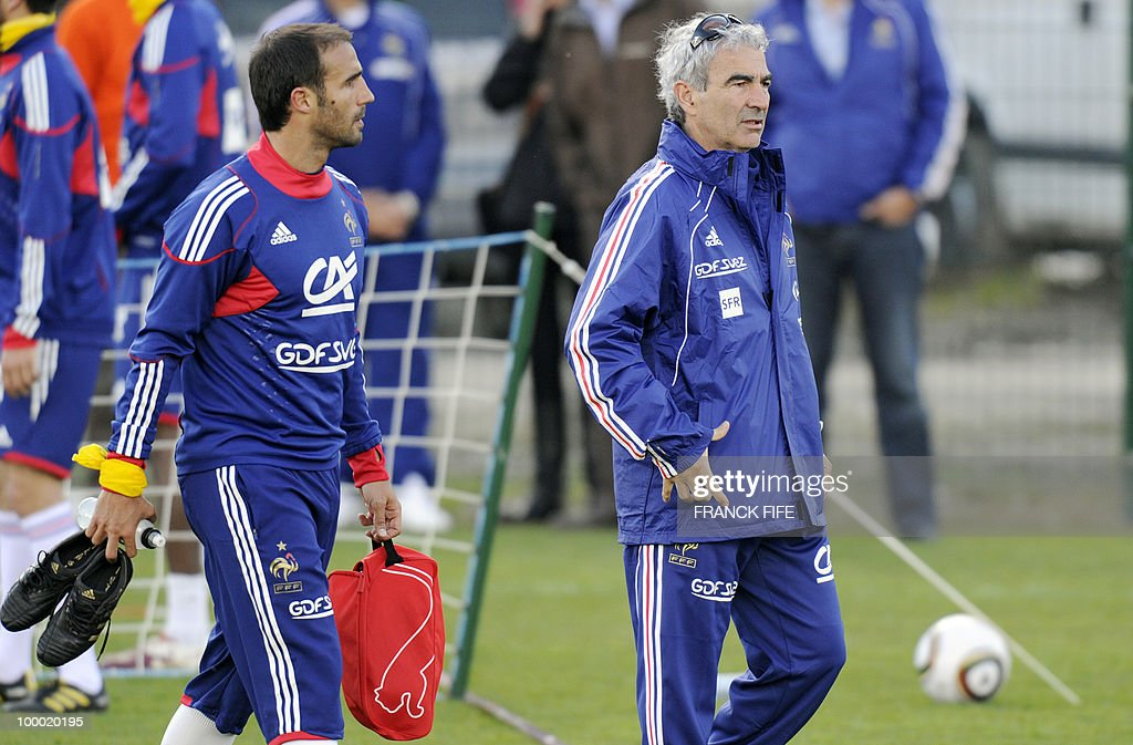 French national football team's defender Marc Planus (L) passes by French national football team's coach Raymond Domenech as he leaves a training session, on May 20, 2010 in Tignes, French Alps, as part of their altitude training in preparation for the 2010 World cup in South Africa. France will play Uruguay in Capetown in its group A opener match on June 11.