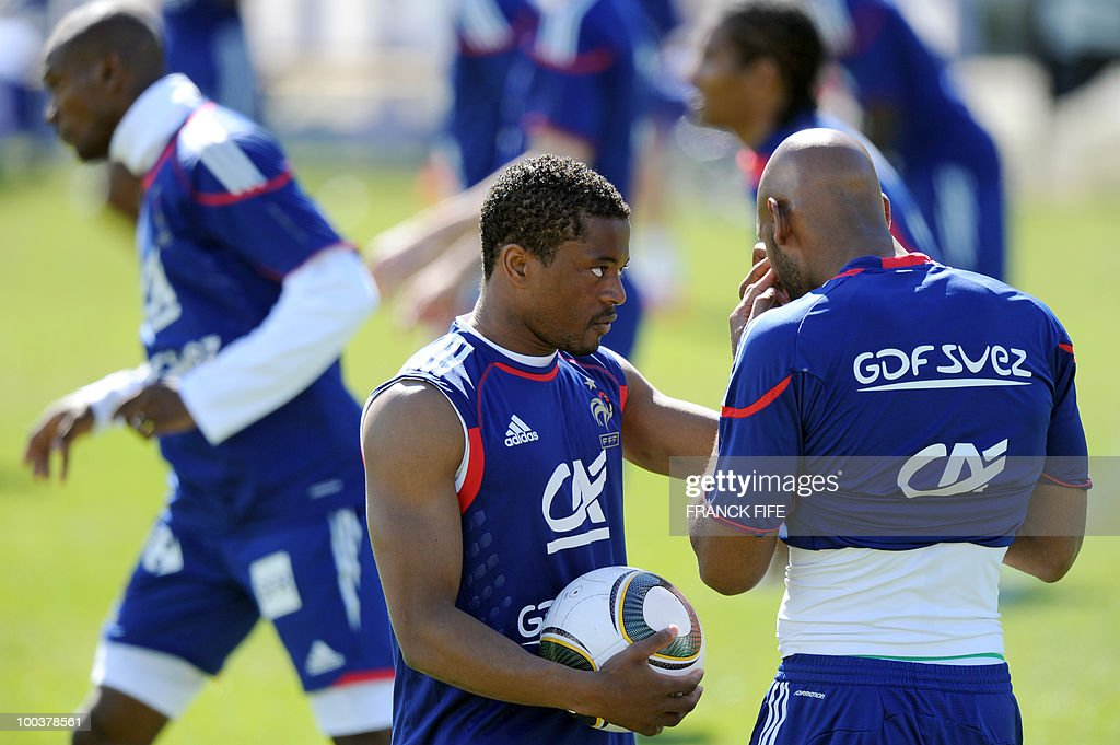 French national football team's defender Patrice Evra (L) and Nicolas Anelka attends a training session, on May 24, 2010, near Tignes in the French Alps, as part of the preparation for the upcoming World Cup 2010. France will play against Uruguay in Capetown in its group A opener match on June 11.