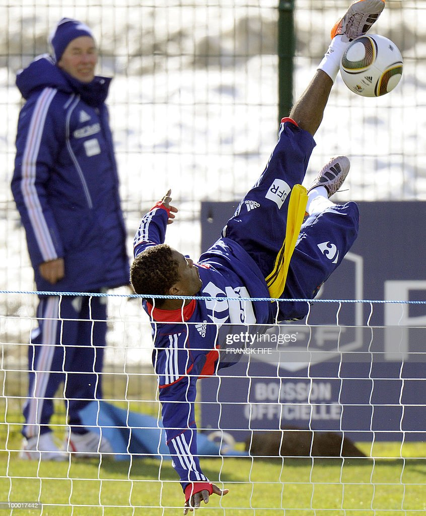French national football team's defender Patrice Evra does a bicycle kick during a training session, on May 20, 2010 in Tignes, French Alps, as part of their altitude training in preparation for the 2010 World cup in South Africa. France will play Uruguay in Capetown in its group A opener match on June 11.