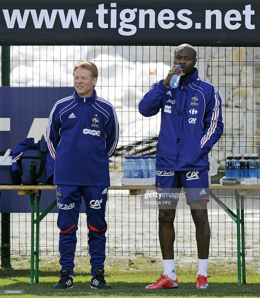 French national football team's defender William Gallas (R) drinks water next to French physiotherapist Michel Brohan before a training session, on May 20 , 2010 in Tignes, French Alps, as part of their altitude training in preparation for the 2010 World cup in South Africa. France will play Uruguay in Capetown in its group A opener match on June 11.