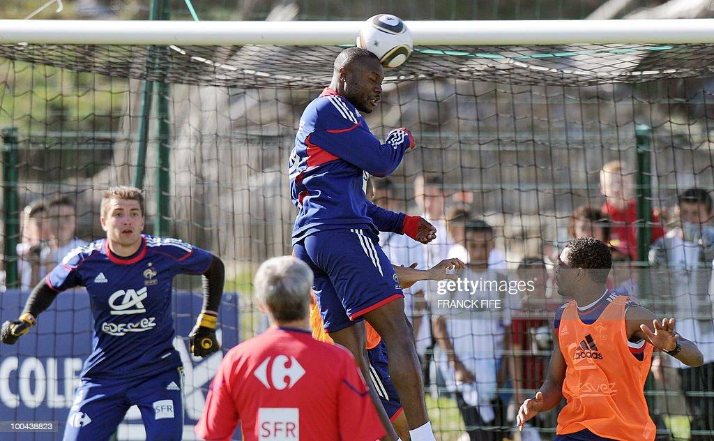French national football team's defender William Gallas (C) heads the ball between defender Patrice Evra (R) and goalkeeper Cedric Carrasso (L) during a training session on May 24, 2010, near Tignes in the French Alps, as part of the preparation for the upcoming World Cup 2010. France will play against Uruguay in Capetown in its group A opener match on June 11.