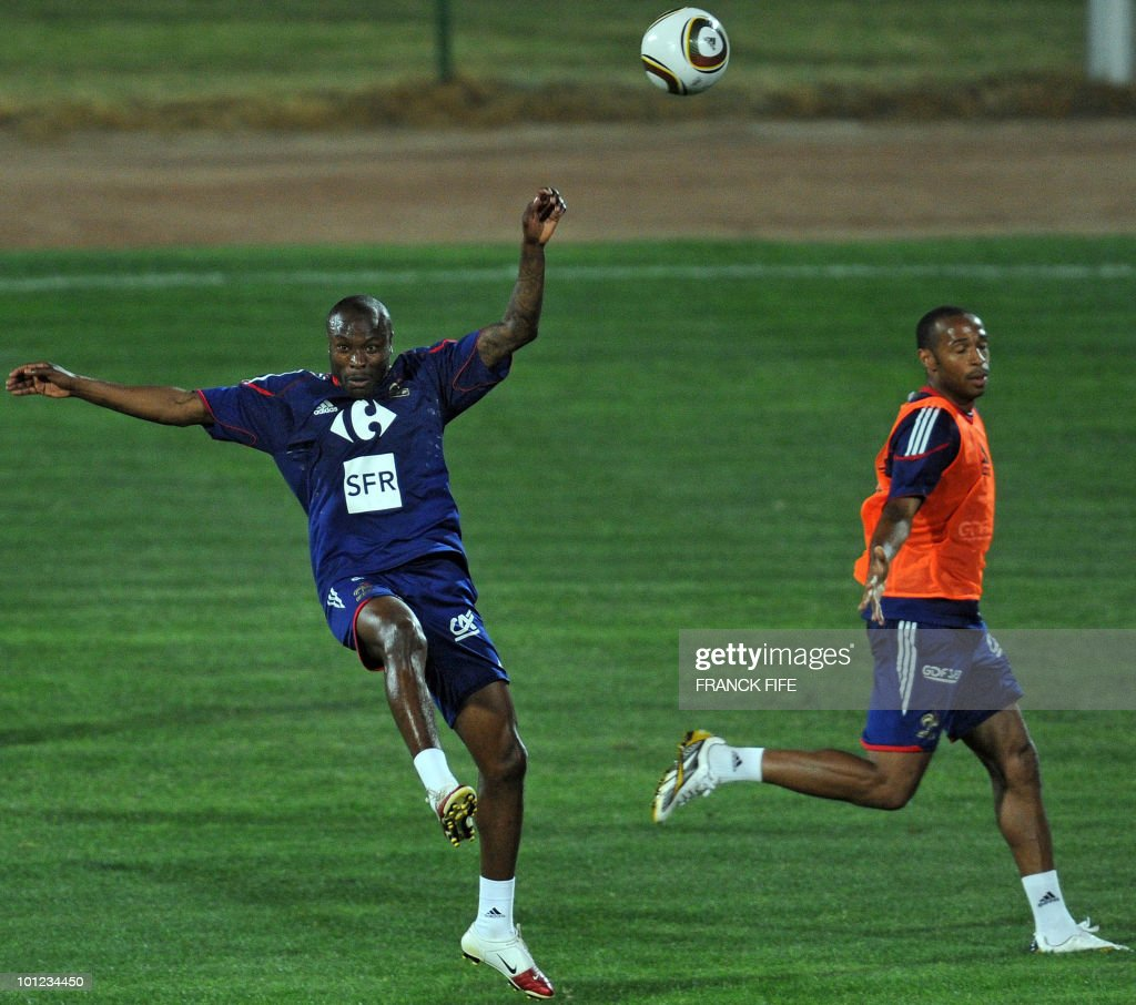 French national football team's defender William Gallas (L) vies with Thierry Henry during a training session, on May 28, 2010, in Sousse, as part of the preparation for the upcoming World Cup 2010. France will play against Uruguay in Capetown in its group A opener match on June 11.