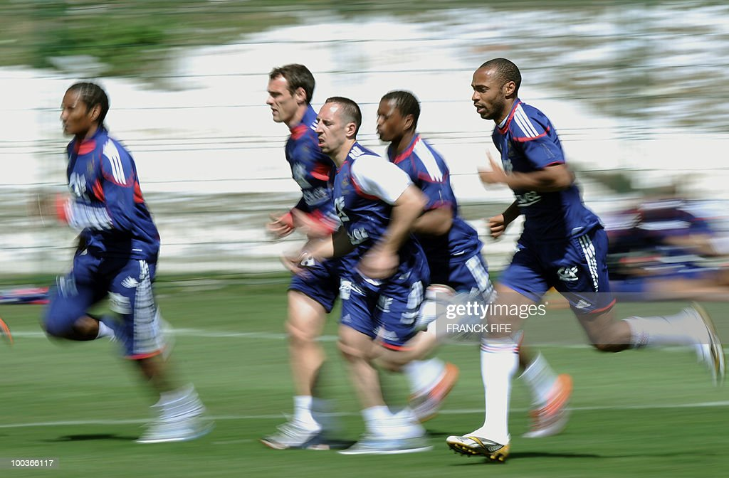 French national football team's Florent Malouda, Sebasien Squillaci, Franck Ribery, Patrice Evra and Thierry Henry run during a training session, on May 24, 2010, near Tignes in the French Alps, as part of the preparation for the upcoming World Cup 2010. France will play against Uruguay in Capetown in its group A opener match on June 11.