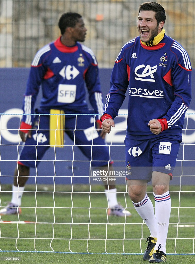 French national football team's forward Andre-Pierre Gignac (R) reacts during a training session, on May 20, 2010 in Tignes, French Alps, as part of the altitude training in preparation for the 2010 World cup in South Africa. France will play Uruguay in Capetown in its group A opener match on June 11.