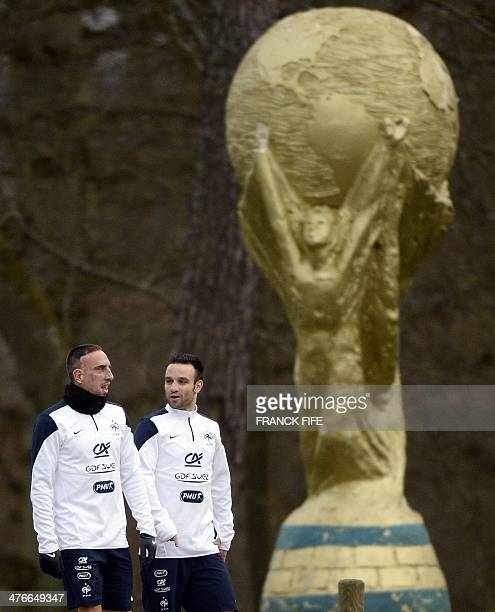 French national football team's forward Franck Ribery and midfielder Mathieu Valbuena arrive for a training session in ClairefontaineenYvelines...