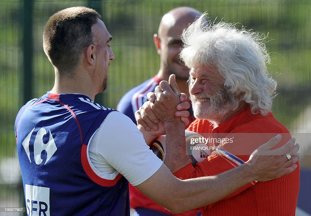 French national football team's forward Franck Ribery (L) is congratuled by a supporter after a training session, on May 24, 2010, near Tignes in the French Alps, as part of the preparation for the upcoming World Cup 2010. France will play against Uruguay in Capetown in its group A opener match on June 11.
