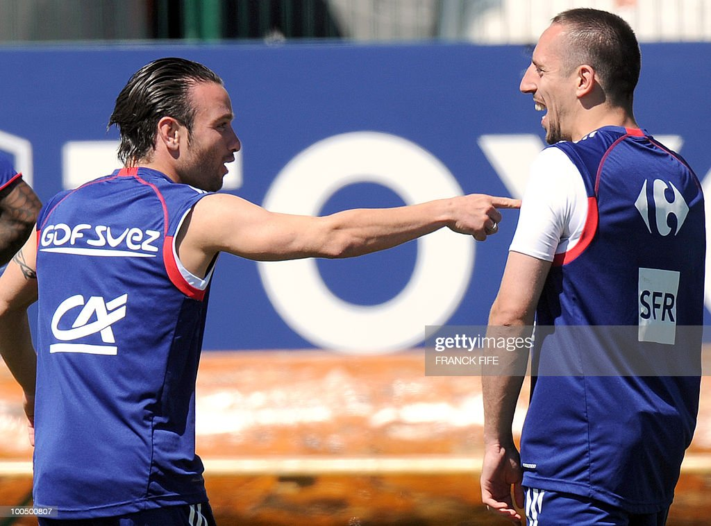 French national football team's forward Franck Ribery (R) shares a laugh with teammate Mathieu Valbuena (L) during a training session, on May 25, 2010, near Tignes in the French Alps, as part of the preparation for the upcoming World Cup 2010. France will play against Uruguay in Capetown in its group A opener match on June 11.