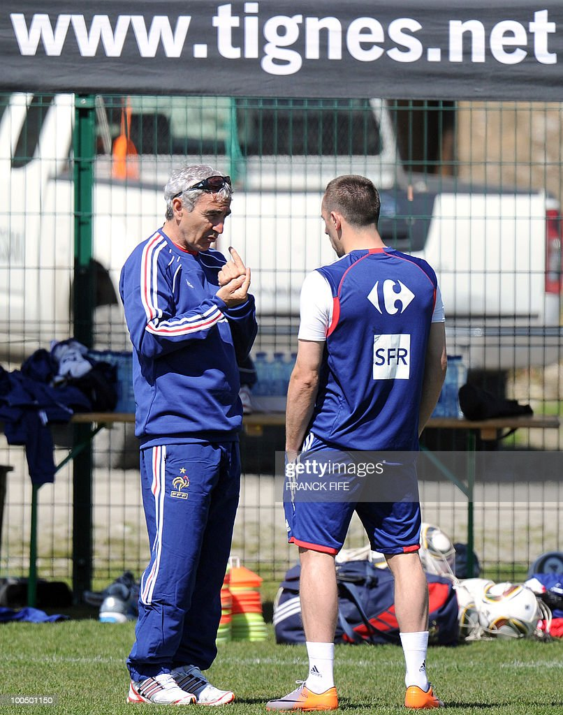French national football team's forward Franck Ribery (R) speaks with his coach Raymond Domenech during a training session, on May 25, 2010, near Tignes in the French Alps, as part of the preparation for the upcoming World Cup 2010. France will play against Uruguay in Capetown in its group A opener match on June 11.