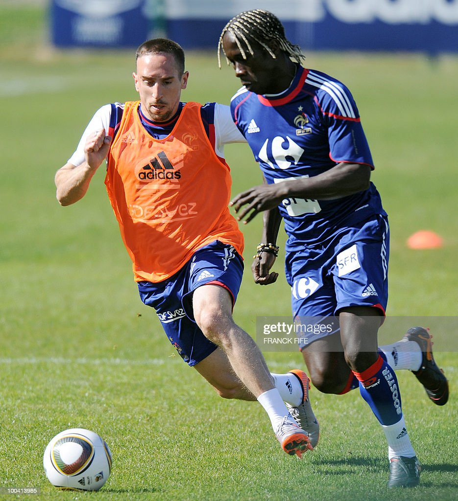 French national football team's forward Franck Ribery (L) vies with defender Bakary Sagna during a training session, on May 24, 2010, near Tignes in the French Alps, as part of the preparation for the upcoming World Cup 2010. France will play against Uruguay in Capetown in its group A opener match on June 11.