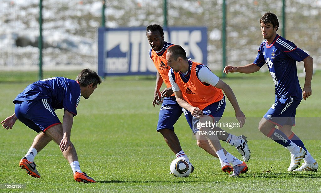 French national football team's forward Franck Ribery (C) vies with Jeremy Toulalan (L) with forward Sidney Govou (2ndL) and midfielder Yoann Gourcuff (R) during a training session on May 24, 2010, near Tignes in the French Alps, as part of the preparation for the upcoming World Cup 2010. France will play against Uruguay in Capetown in its group A opener match on June 11.