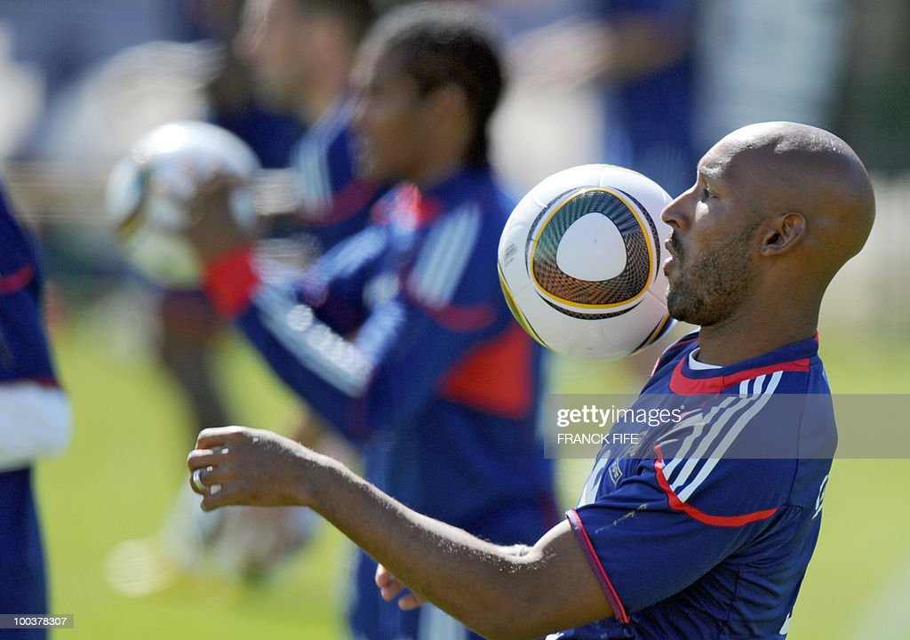 French national football team's forward Nicolas Anelka controls the ball during a training session, on May 24, 2010, near Tignes in the French Alps, as part of the preparation for the upcoming World Cup 2010. France will play against Uruguay in Capetown in its group A opener match on June 11.