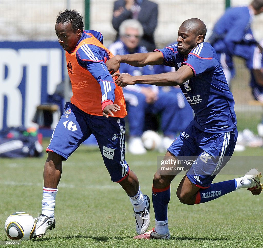 French national football team's forward Sidney Govou (L) vies with teammate, midfielder Abou Diaby during a training session, on May 25, 2010, near Tignes in the French Alps, as part of the preparation for the upcoming World Cup 2010. France will play against Uruguay in Capetown in its group A opener match on June 11.
