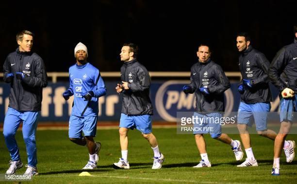 French national football team's goalkeeper Mickael Landreau defender Patrice Evra midfielder Mathieu Valbuena forward Franck Ribery and defender Adil...
