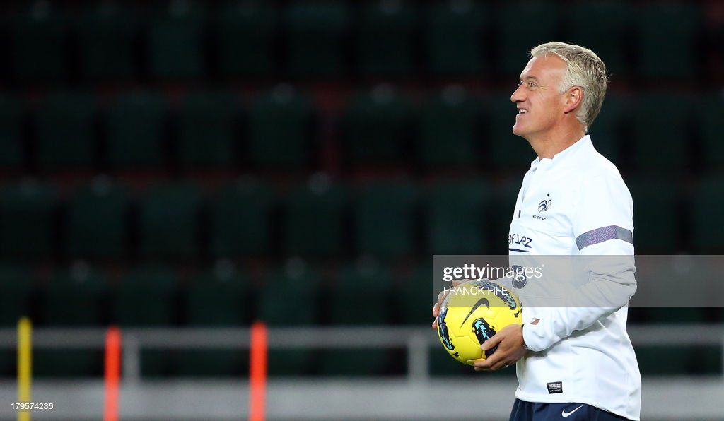 French national football team's head coach Didier Deschamps looks as his players during a training session on September 5, 2013, on the eve of their FIFA World Cup 2014 qualifying football match Ge...