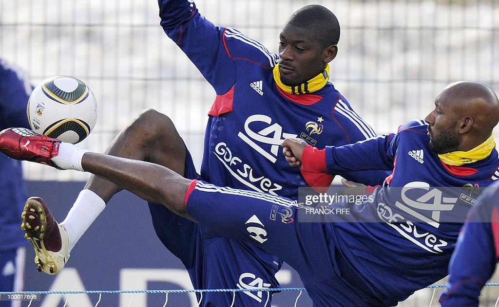 French national football team's midfielder Abou Diaby (L) vies with forward Nicolas Anelka during a training session, on May 20, 2010 in Tignes, French Alps, as part of their altitude training in preparation for the 2010 World cup in South Africa. France will play Uruguay in Capetown in its group A opener match on June 11.