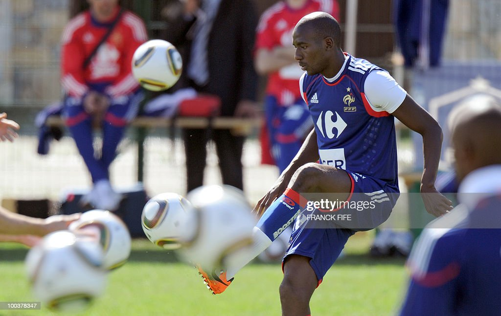 French national football team's midfielder Alou Diarra juggles with a ball during a training session, on May 24, 2010, near Tignes in the French Alps, as part of the preparation for the upcoming World Cup 2010. France will play against Uruguay in Capetown in its group A opener match on June 11.