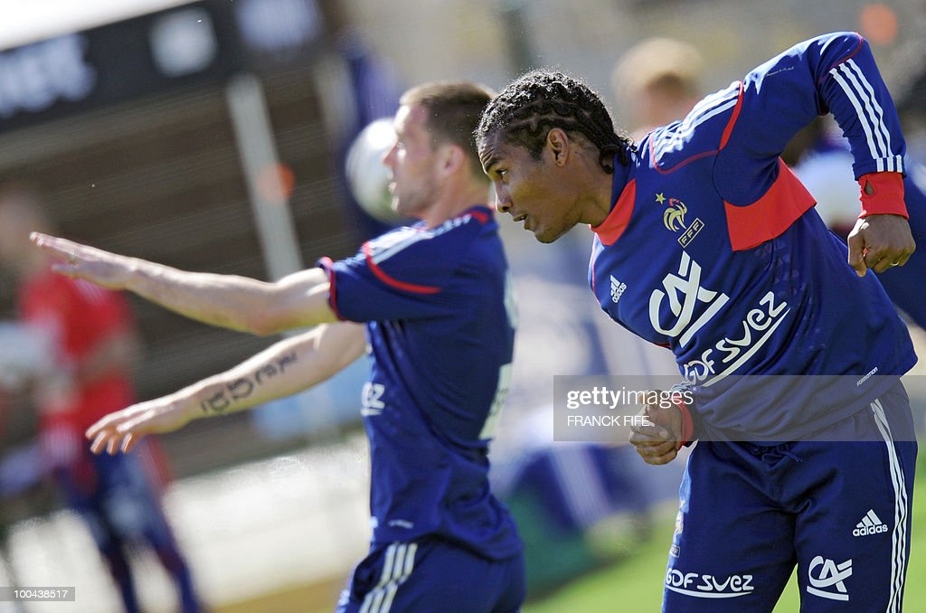French national football team's midfielder Florent Malouda (R) jumps during a training session, on May 24, 2010, near Tignes in the French Alps, as part of the preparation for the upcoming World Cup 2010. France will play against Uruguay in Capetown in its group A opener match on June 11.