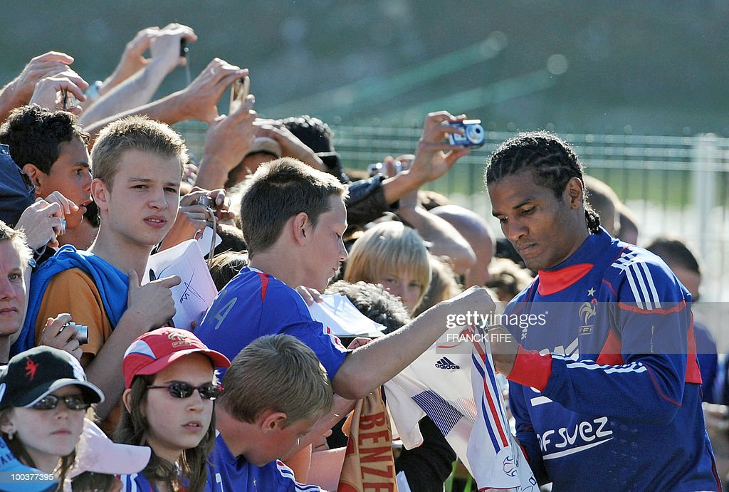 French national football team's midfielder Florent Malouda signs a autographs after a training session, on May 24, 2010, near Tignes in the French Alps, as part of the preparation for the upcoming World Cup 2010. France will play against Uruguay in Capetown in its group A opener match on June 11.