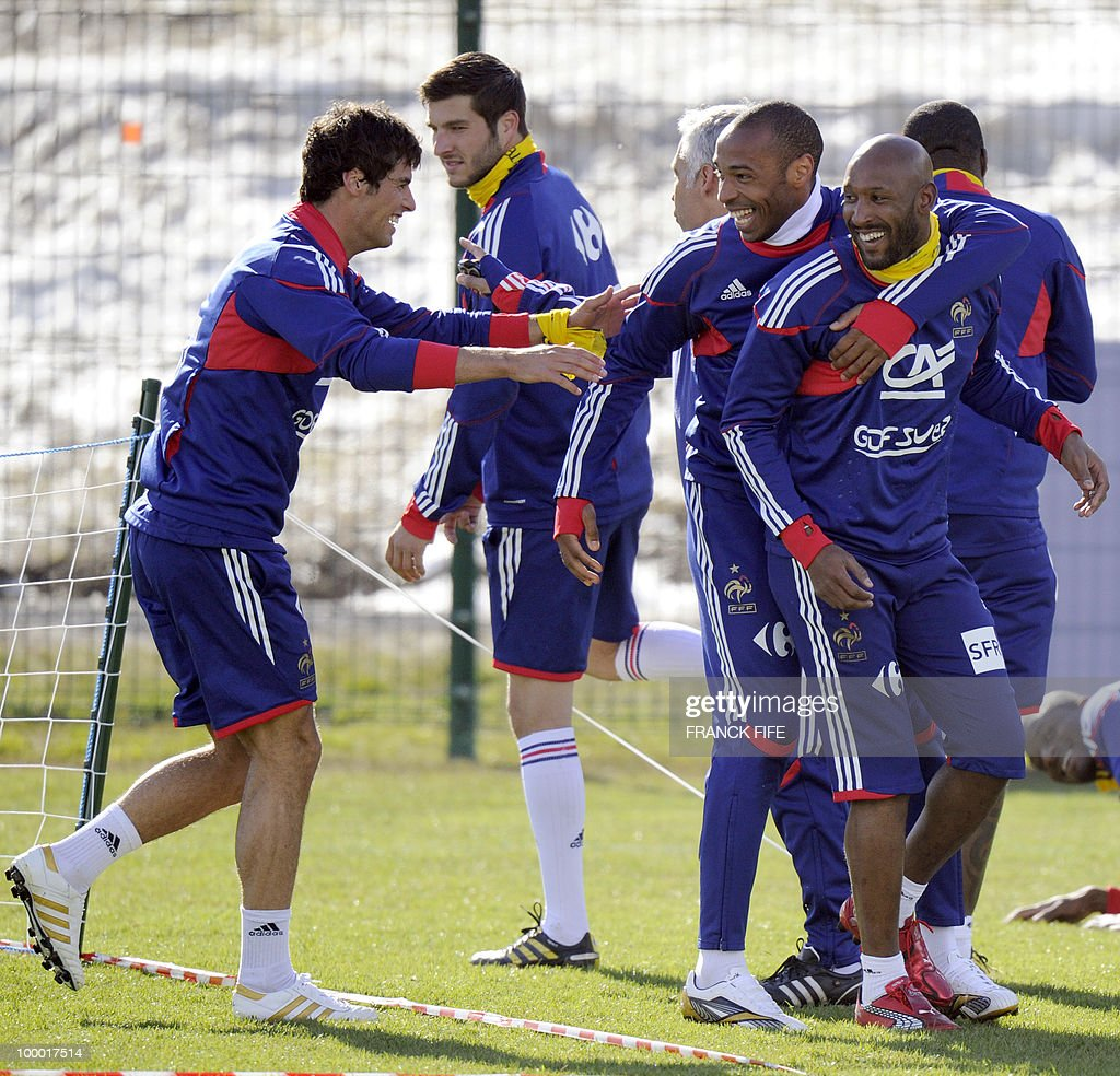 French national football team's midfielder Yoann Gourcuff (L) jokes with captain Thierry Henry (C) and Nicolas Anelka (R) during a training session, on May 20 , 2010 in Tignes, French Alps, as part of their altitude training in preparation for the 2010 World cup in South Africa. France will play Uruguay in Capetown in its group A opener match on June 11.